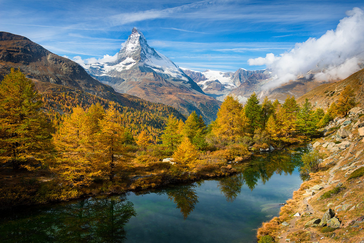 My favorite Viewpoint in October: Grindjisee in front of golden yellow firs and mount Matterhorn