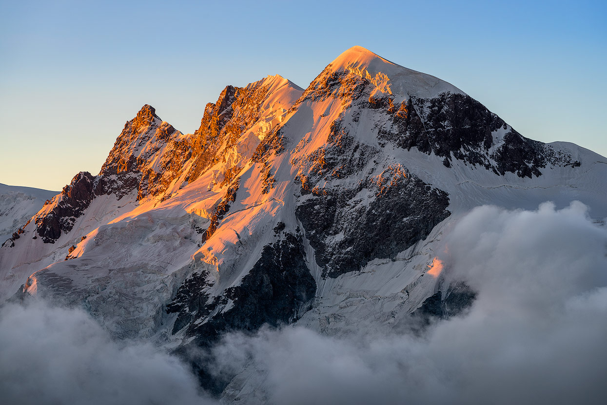 Moody Sunset on mount Breithorn. This shot has been taken from the Hörnlihütte with a zoom lens