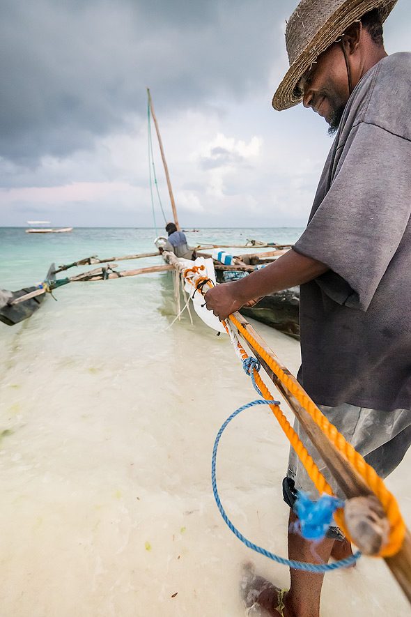 A fisherman prepares his dhow